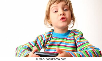 girl holds communicator in her hands