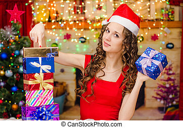 Girl holds gift and points a finger at others