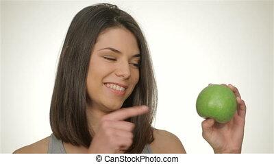 Girl holds green apple