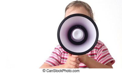 Girl holds loudspeaker near the mouth, then turns aside and...