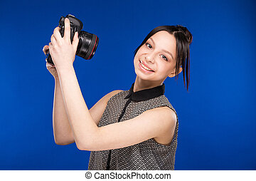 girl holds the camera in hands