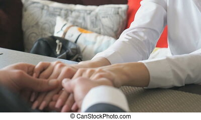 Girl holds the hand of her boyfriend. Close-up