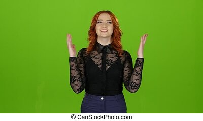 Girl hoping to smile at the positive answer crossed her fingers. Green screen