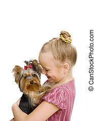 girl hug a little Yorkshire Terrier puppy