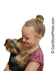 girl hug a little Yorkshire Terrier puppy. isolated on white