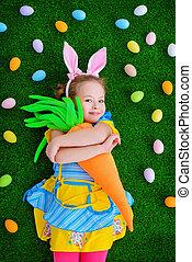 girl hugging a carrot