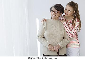 Girl hugging her grandma