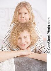Girl hugging her mom