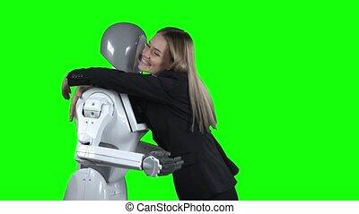 Girl hugs the robot. Green screen - Girl hugging a robot,...
