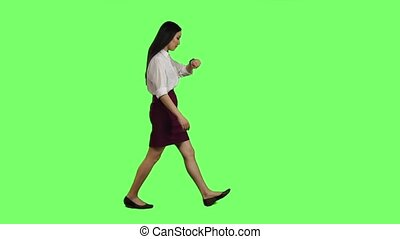 Girl hurries to the negotiations, she does not have time, starts to run. Green screen. Slow motion