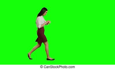 Girl hurries to the negotiations, she does not have time, starts to run. Green screen