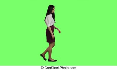 Girl hurries to the negotiations, she does not have time. Green screen. Slow motion