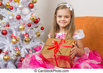 girl in a beautiful dress gave New Year gift