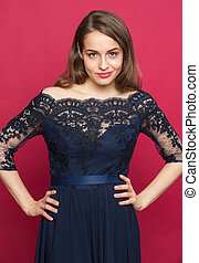 Girl in a beautiful dress on a colored background