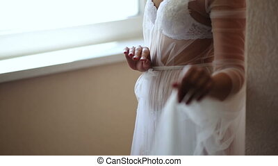 Girl in a beautiful white peignoir at the window