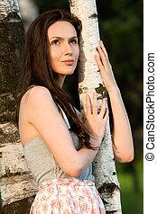 Girl in a birch grove