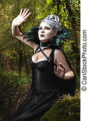 Girl in a black dress. - Gothic girl in black dress looking...