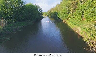 Girl in a blue kayak floating. Aerial video. 4k 30fps