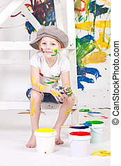 girl in a cap with paints