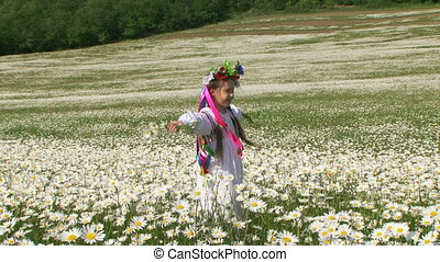 Girl in a chamomile field