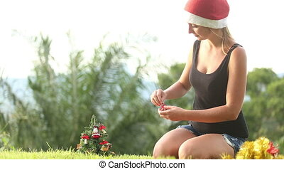 girl in a Christmas hat decoration with bells a Christmas