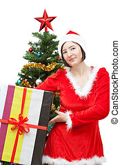 Girl in a Christmas outfit and gift