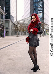 girl in a city - portrait of a girl with red hair, leather...