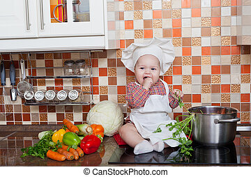 Girl in a cook cap with a ladle in a hand sits on a kitchen...