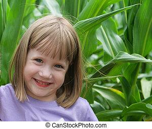 Girl in a corn field
