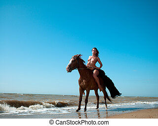 girl in a dress on a horse by the sea - girl in an evening...
