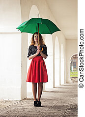 Girl in a dress with an umbrella