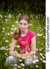 girl in a field of daisies