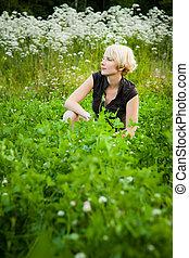 Girl in a field of flowers
