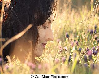 Girl in a field of flowers.
