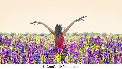 Girl in a field of lupines, panorama