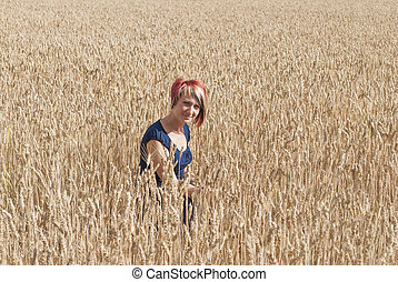 Girl in a field of wheat.