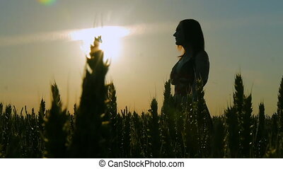 girl in a field smiling emotions hands dancing