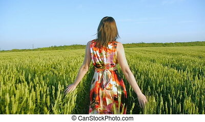 girl in a field smiling emotions hands dancing ears laughs runs listening to music girl portrait sun beautiful sunset light dress posing road smile mystery