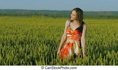 girl in a field smiling emotions hands