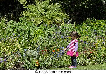 Girl in a flowering garden