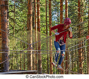 Girl in a Forest Rope Park Challenge