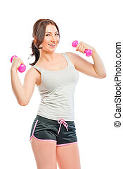 girl in a gray t-shirt with dumbbells for sports