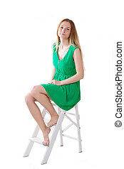 girl in a green dress sitting on stepladder
