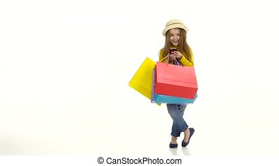 Girl in a hat with package holding phone and pishit posts. White background. Slow motion