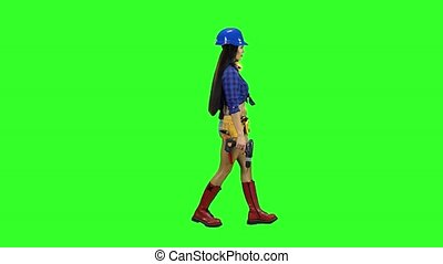 Girl in a helmet and with headphones on her neck goes sideways on a green background