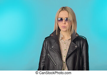 Girl in a leather jacket in retro style