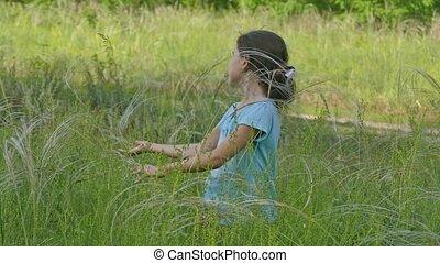girl in a meadow in summer hobbling slow motion video