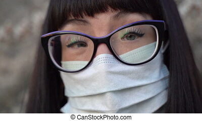 Girl in a medical mask. Coronavirus epidemic - A girl in a ...