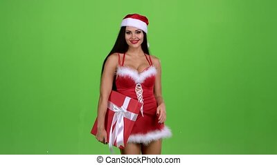 Girl in a new year costume holds a gift in her hand. Green screen