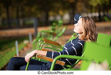 Girl in a Parisian park enjoying sunny day